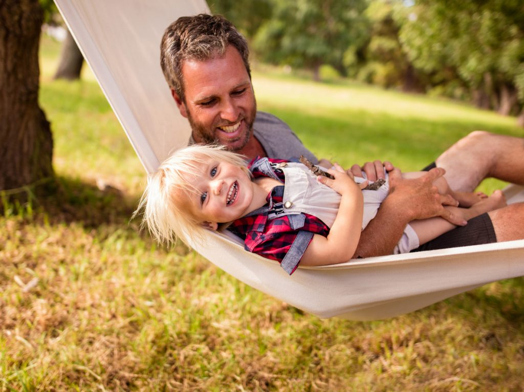 father and son in a hammock at a Tuscaloosa Northport Park