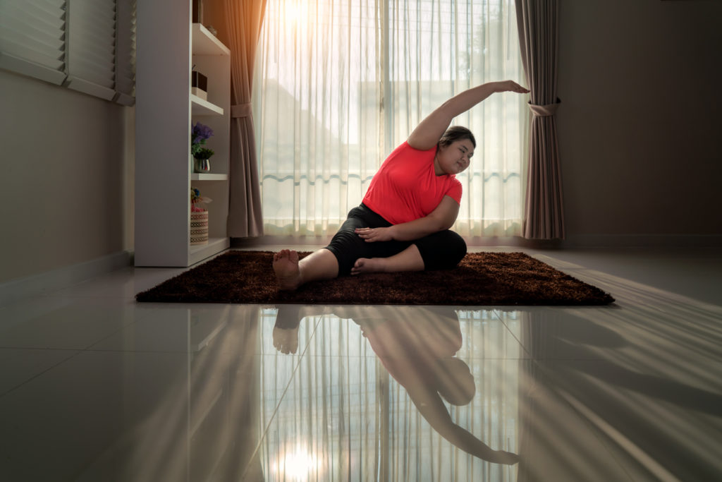 Woman doing yoga poses at home