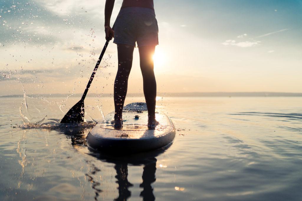 Woman paddleboarding on the lake