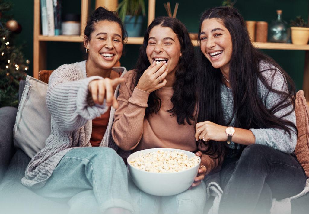 Girls laughing at movie