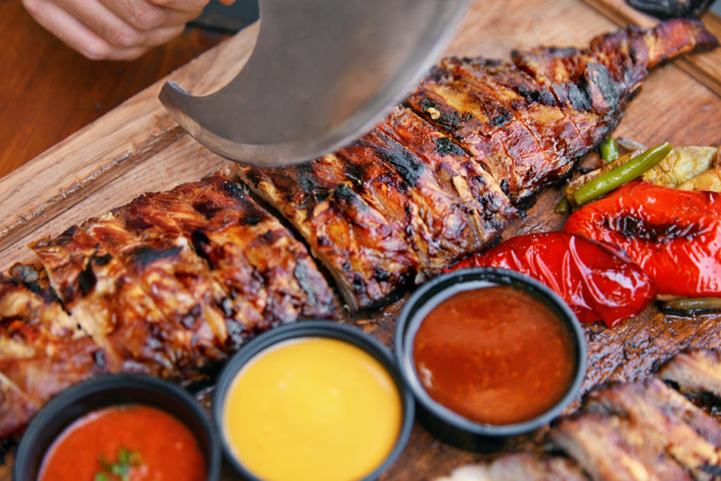 Barbecue Ribs And Sauces In Restaurant