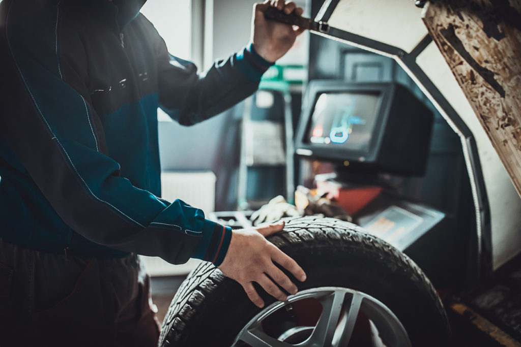 Mechanic balancing a tire in auto repair shop